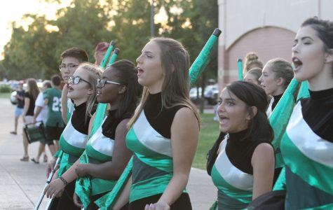 Twirling for her school: Color guard member Katharine Strong, freshman, prepares for homecoming