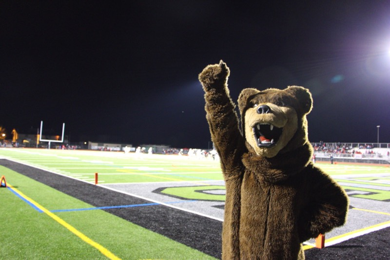 The Grizzly Bear mascot helps celebrate the football team's 38-0 victory against Antelope in Friday's Div. 2 section playoff game.