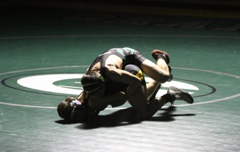 Wrestling coach Cooley commits to his profession