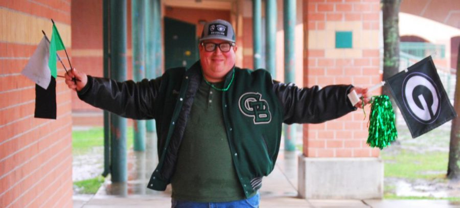 Noah+Frank+poses+with+his+favorite+tribe+gear+that+he+wears+to+every+varsity+football+game.++Frank+is+often+seen+with+this+gear+at+the+front+of+the+stands%2C+cheering+on+the+team.+