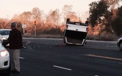 Pick-up truck overturns following nearby accident during morning rush