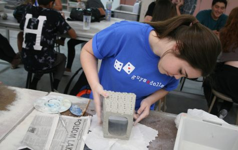 "HARDWORKING ART: In Mr. Ron Owens ceramics class, junior Bailey Bradford smooths out the edges of her box. Bradford wanted to make it look nice since she will have it for a long time. ""I take as much time as I need so I can get my best quality work,"" Bradford said. Photo by Nishita Fernandes"
