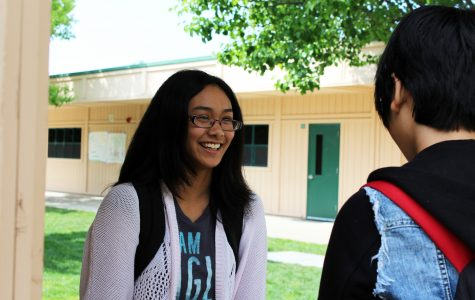 "CHIT CHAT:  Although freshmen Carissa dela Cruz and Amy Hung had to leave soon, they waited and talked to each other before their rides showed up. ""Taking the time to catch up with friends is important and laughing together makes the day better,"" dela Cruz said. After talking about the English book they were reading in class, the two friends split up and went home. Photo by Lindsay Withrow"