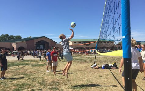 A volleyball game in progress in the quad.