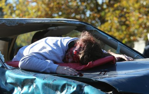 Junior Ryan Hunter appears dead in drunk driving simulation.