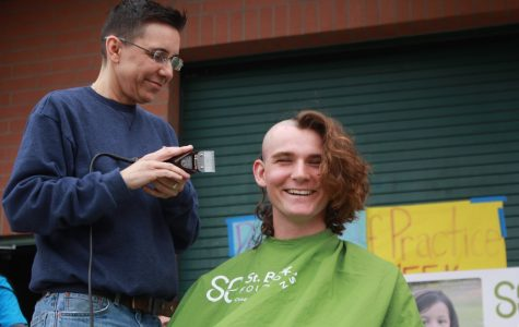 Students shave their heads and raise donations for childhood cancer