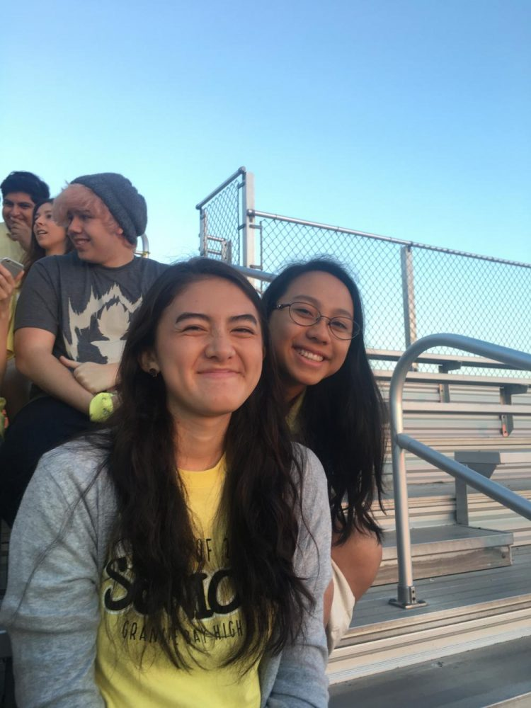 In front and center, from left to right: Gwendolyn Porter and Divya Shetty Friends smile and pose for a photo at Senior Sunset
