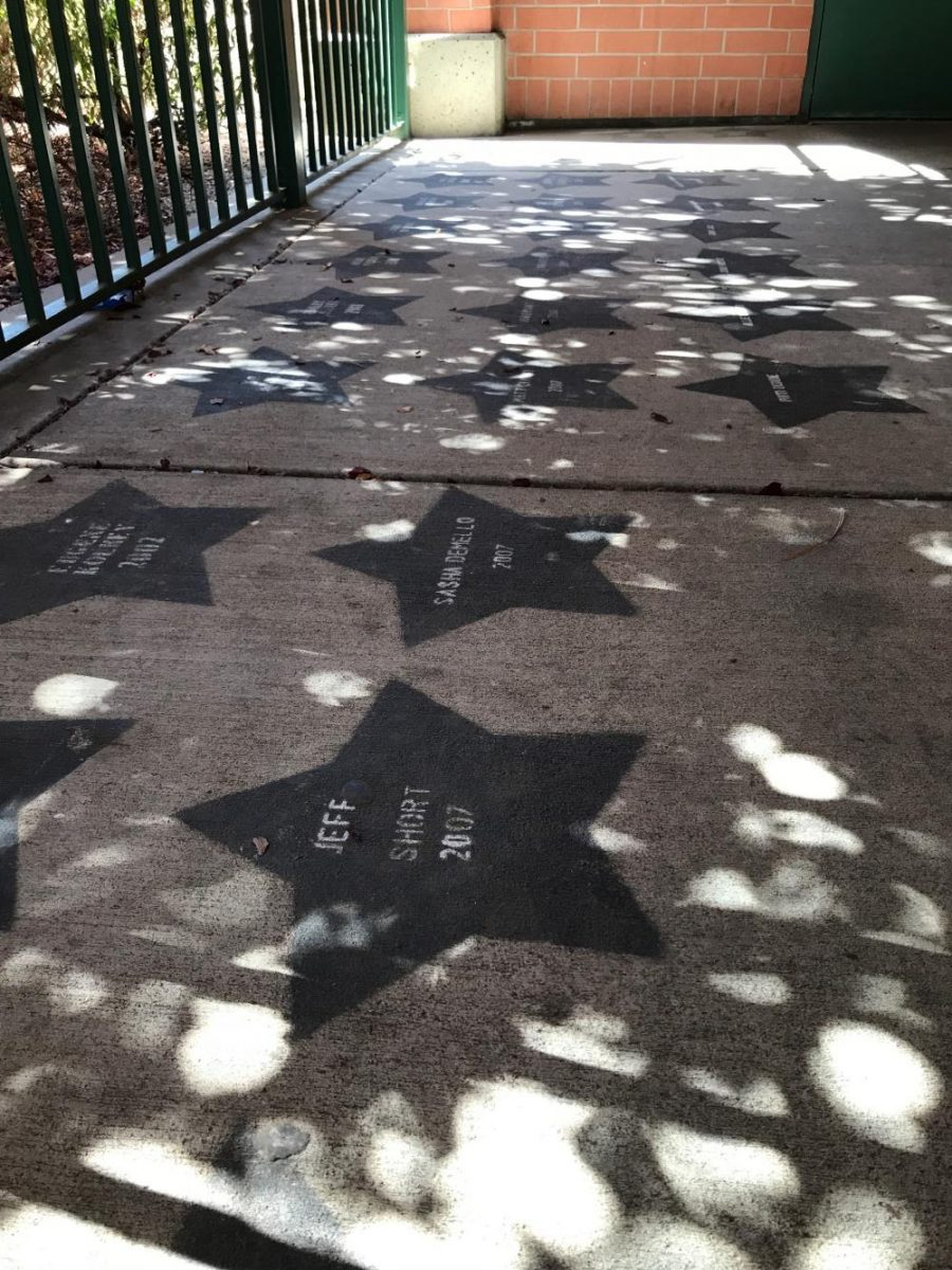 Like the streets near Hollywood, stars outside the entrance to the video studio near the library honor former students who were part of the media program at Granite Bay High. This year, the media program is no longer producing video bulletins.