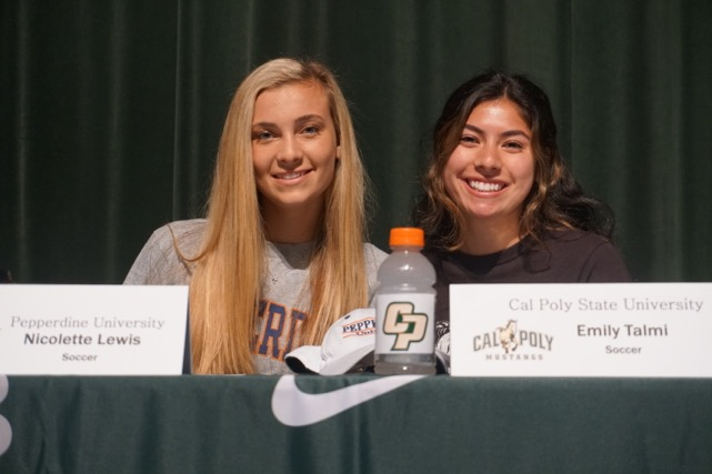 Nicolette Lewis (left) and Emily Talmi commit their attendance to Pepperdine and Cal Poly on signing day.