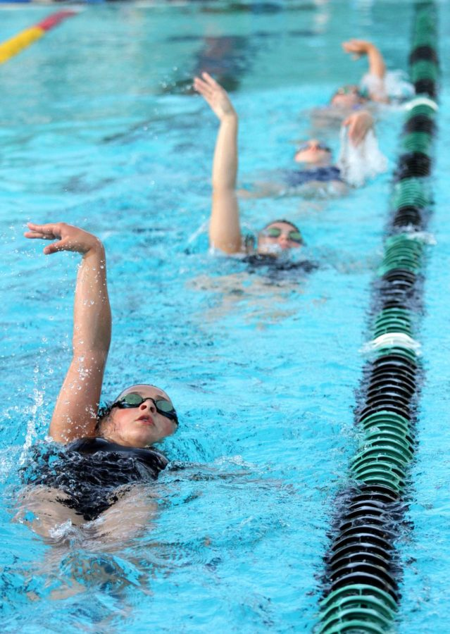 The girls swim team at GB are undefeated league champions, and they practice to win.