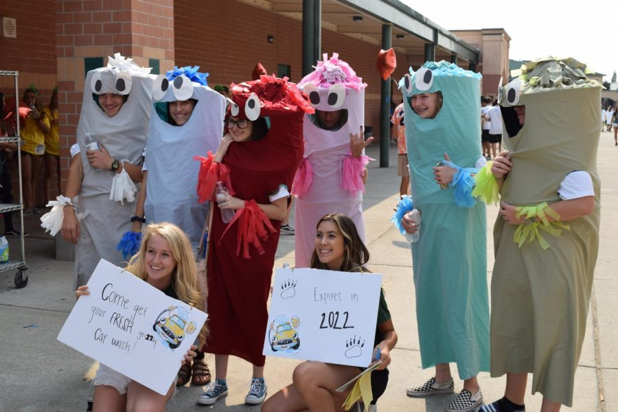 Link Crew is a huge part of Grizzly Retreat, freshmen orientation. Izzie Winger, bottom left, and Karissa Hodson, bottom right, pose with their freshmen dressed as inflatable tube men.