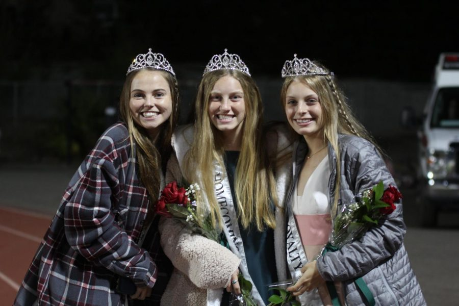 Senior royalty, Kate Caulfield, left, Rebecca King, middle, and Abbie Gould, pose after the halftime homecoming ceremonies.