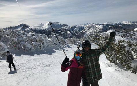 Senior Hannah Coons and her brother enjoy a day on the slopes.