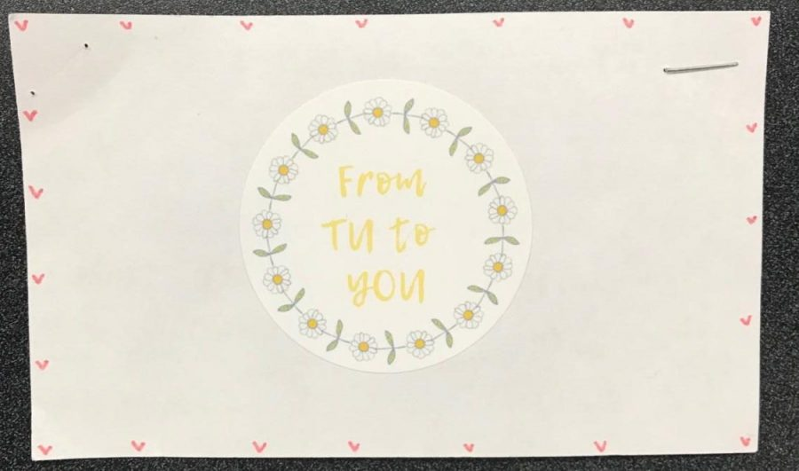The logo for Michelle Tu's business -- Tu sells handmade scrunchies.