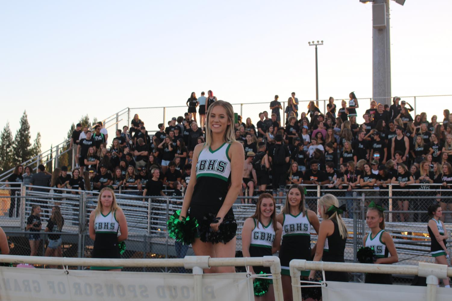 Senior Faye Miller cheering on the sideline of a GBHS varsity football game
