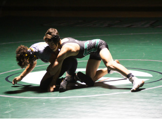 Gabe Jensen takes down an opponent at a home duel vs Del Oro