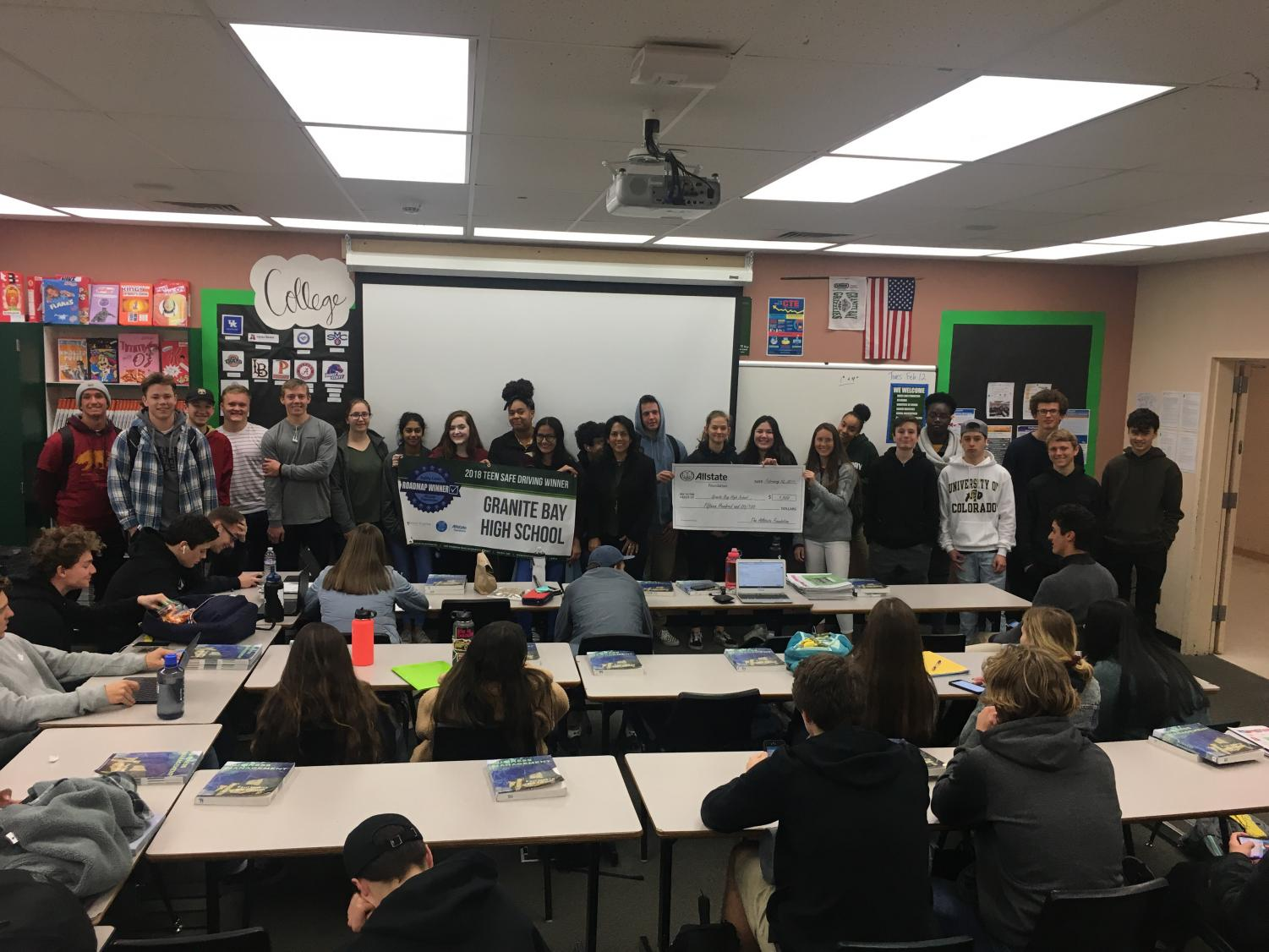 The Sports and Entertainment Marketing class receives a $1,500 check and a banner after getting first place in the Teen Safe Driving Campaign put on by Allstate.