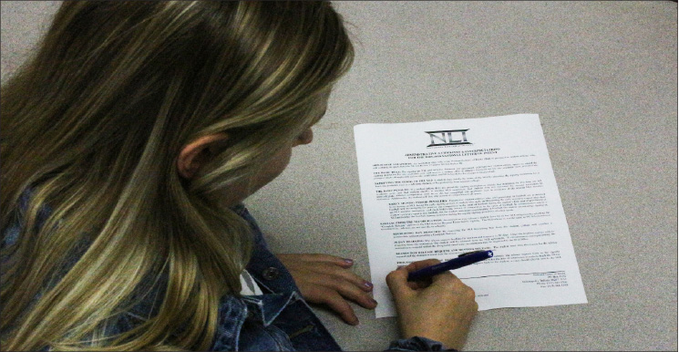 Signing+a+letter+of+intent+is+one+part+of+the+recruitment+process+for+potential+college+athletes.