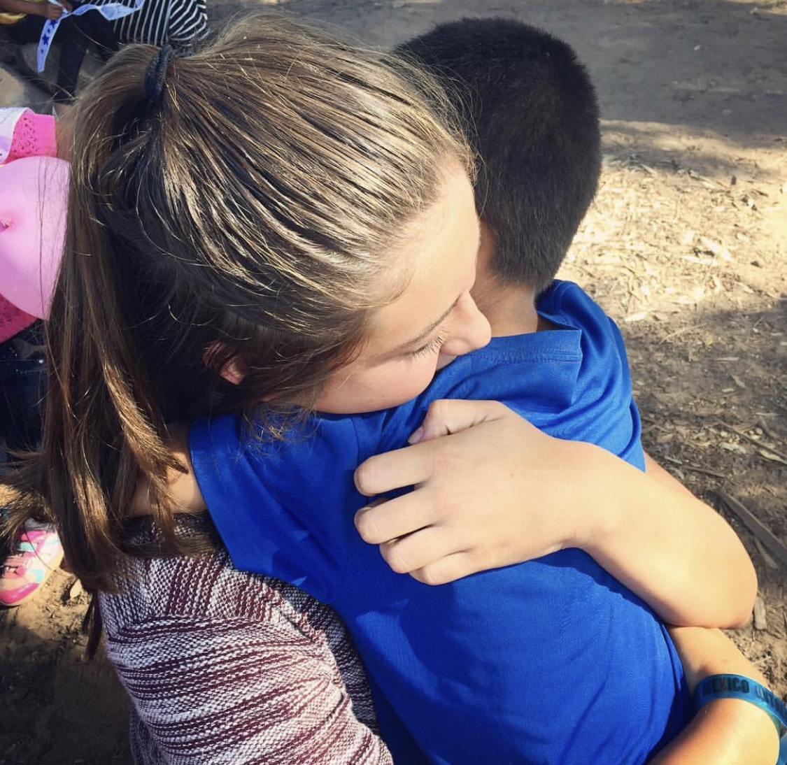 A student hugs a child while volunteering at Mexicali. The Mexicali trip through Bayside is a popular volunteer opportunity for Granite Bay High School students. Many students volunteer through Bayside Church for service hours.