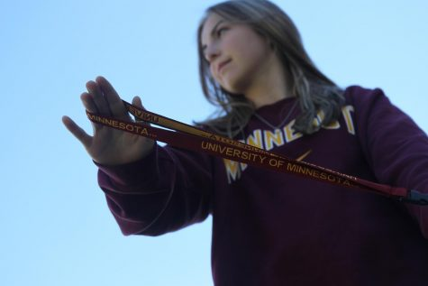 Proudly showing off her key chain, sophomore Aynsley Conner supports the University of Minnesota after being offered a scholarship.