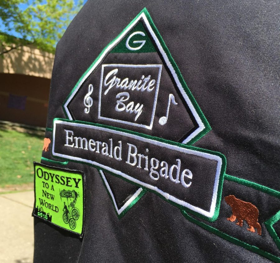 Worn on a constant basis, Kyra Martin loves her Emerald Brigade jacket. Many students in the band have and wear their embroidered letterman jackets with pride.