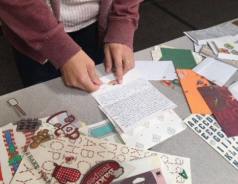 Penpal club member Paloma Garcia adds the last finishing touches to her letter for her special pal.