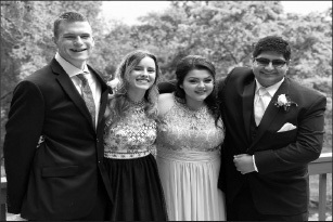 GBHS student Daniel Patterson and alumni Olivia Caserta, Laynee Daniels and Angikaar Chana (left to right) take photos before Senior Ball