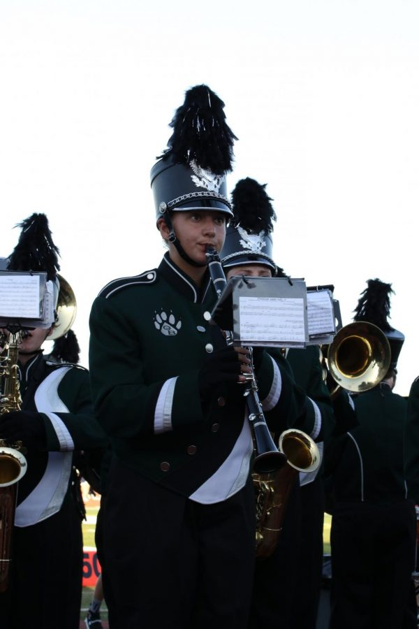 Annika Vaatveit plays the clarinet during the before a football game before the pandemic hit