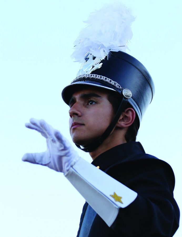 Daven Kashyap, this year's drum major for Emerald Brigade, leads his fellow band members during a recent football game.