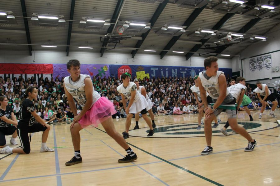 Players on the football team dance their traditional homecoming cheer routine.