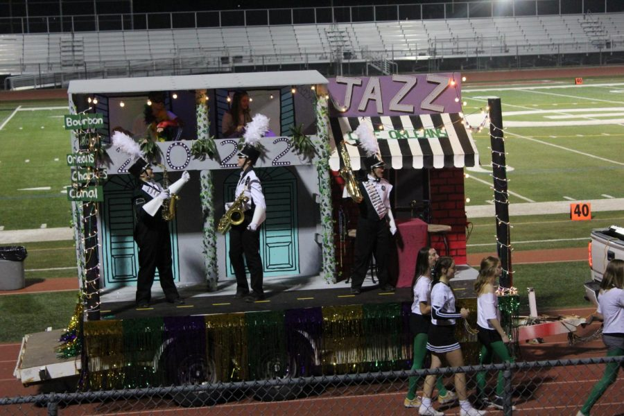 Angelica Christe, Tawny Perez, and Nate Stebbins along with other sophomores ride into homecoming smooth as the blues on their jazzy float.