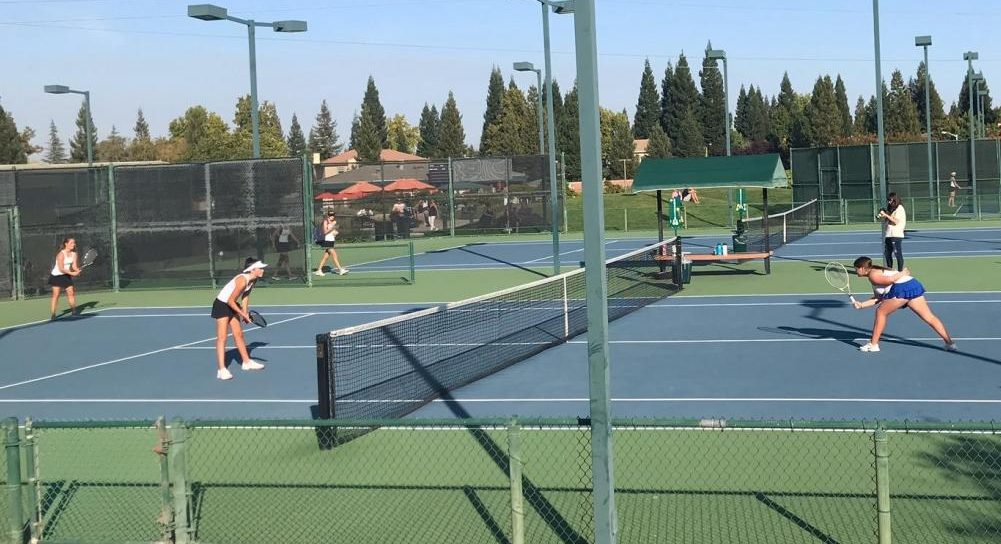 Kaylee Price and Raylie Dawson play Rocklin at their JV match on Monday.