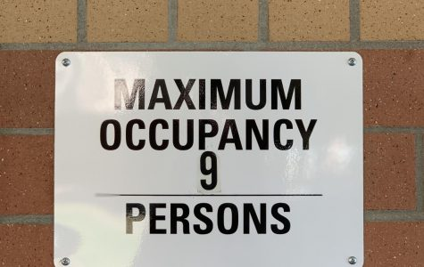 Maximum occupancy signs are affixed next to every bathroom on campus with multiple stalls.