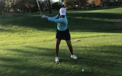 Dedicated player Anika Varma swings back on the golf course.