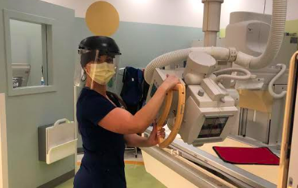 Britni Rowe, a radiologist at Kaiser Hospital Roseville, poses  must wear extensive amounts of  PPE, or personal protective equipment, during the coronavirus pandemic.