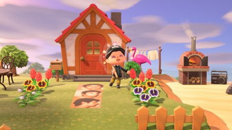 The player character in Animal Crossing: New Horizons poses to show off their home.