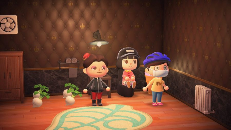 Three real-life players congregate in a house in Animal Crossing: New Horizons.