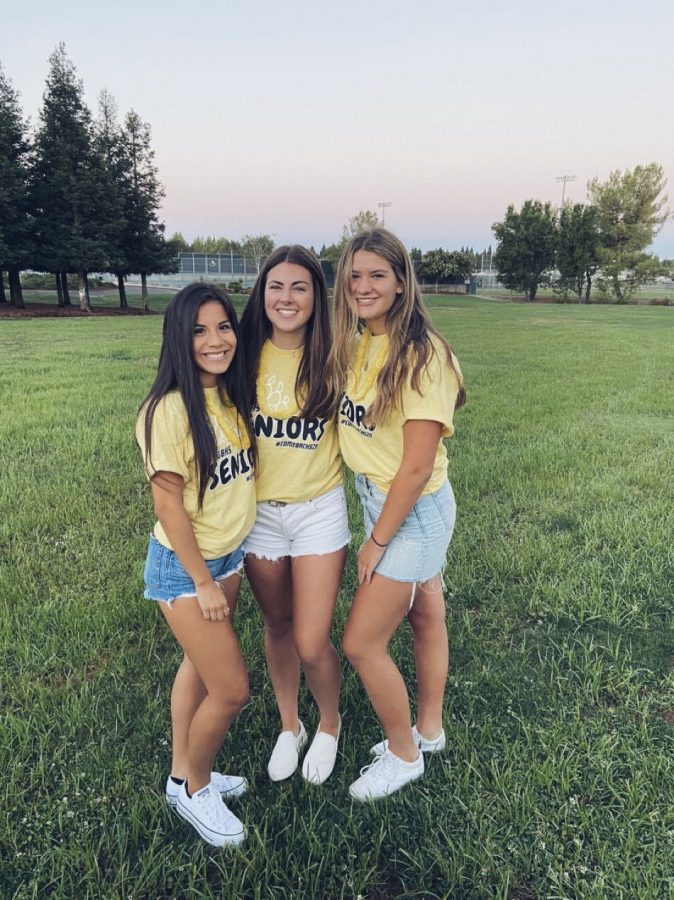 Seniors Grettel Sainz, Quinn Mullany and Emma Shores gather at Feist Park on the first day of school.