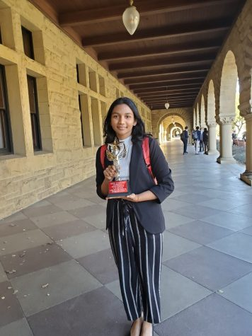 Junior Shreya Nagunuri poses after a debate competition