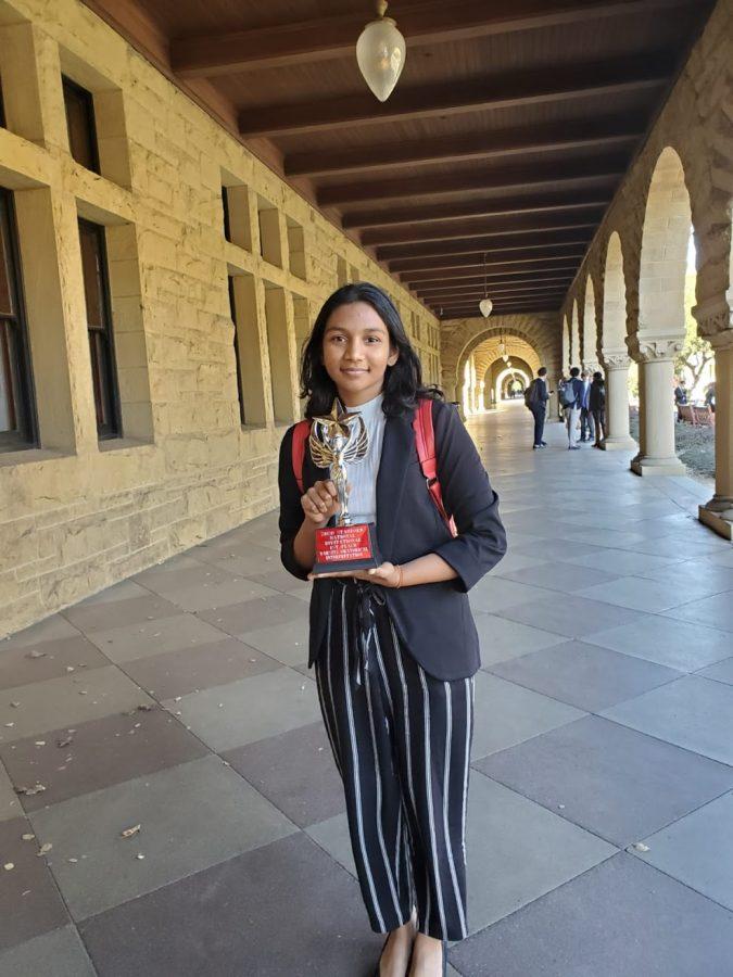 Junior Shreya Nagunuri poses after a debate competition