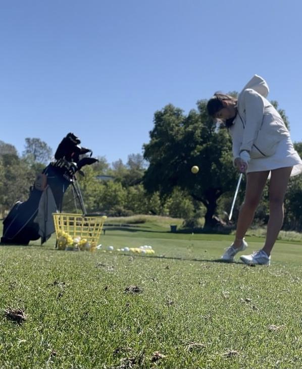 Lauren+Pierce+strikes+a+shot+at+range+practice.+%0A%0A