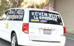 A supporter of Kevin Kiley drives along Highway 680.