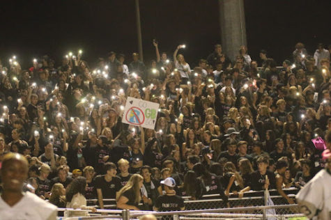 Many people among the student section crowd turn on the flash on their phones during the Granite Bay vs. Rocklin football games as a sign of support for our team.